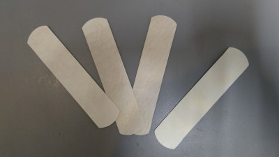 self adhesive parchment (bandages)